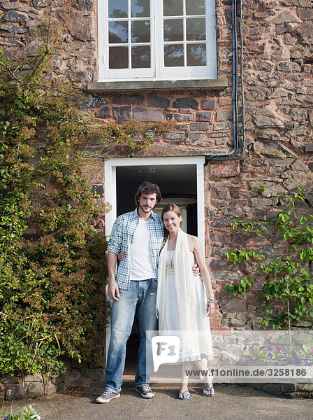 Man and woman outside country house
