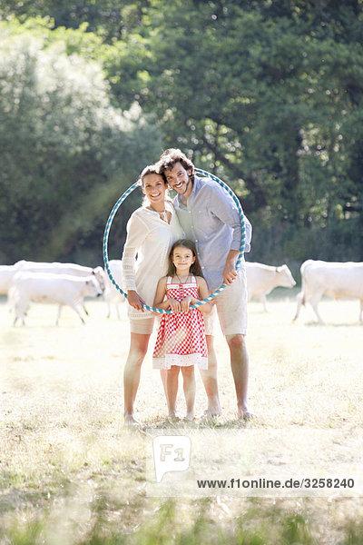 Family portrait with hoop in field