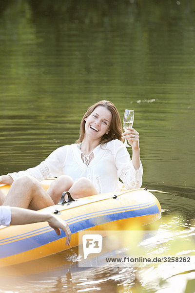Woman laughing in dinghy in lake