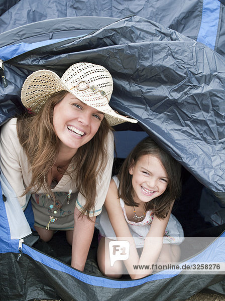 Mother and child emerging from tent
