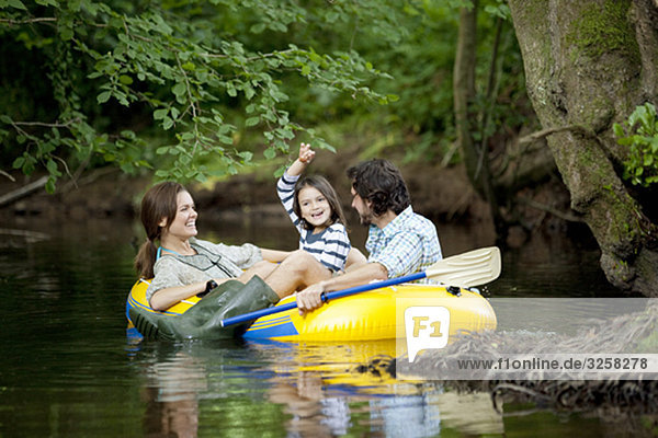 Family in dinghy on lake