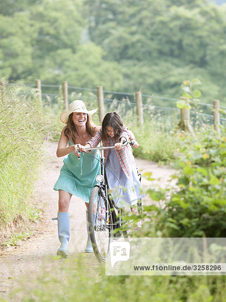 Mother with daughter on bicycle