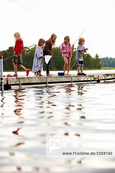 Children on a jetty  Sweden.
