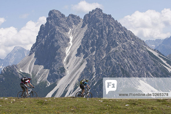 Italy  Dolomites  Couple mountainbiking