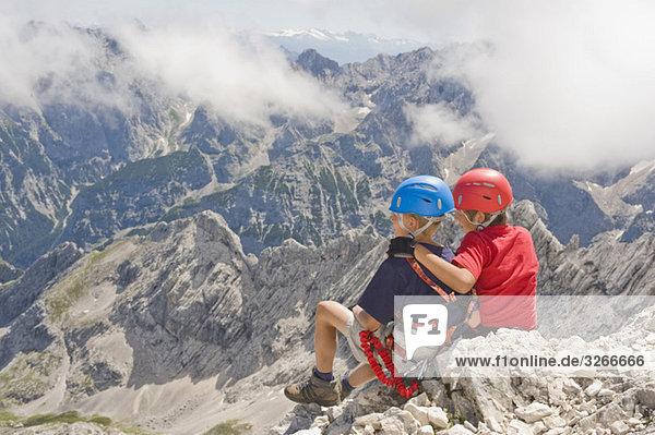 Mountaineers  Boys (10-11)  (12-13) sitting on rock