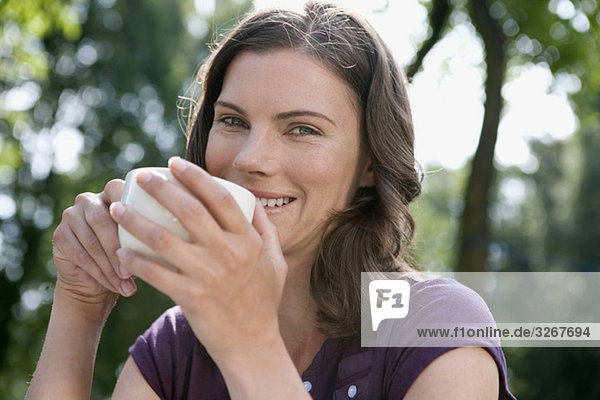 Woman holding cup of coffee  portrait  close-up