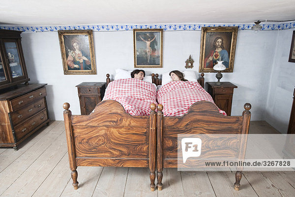 Germany  Bavaria  Young couple lying in bedroom