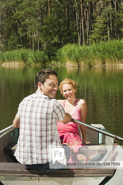 Italy  South Tyrol  Couple in rowing boat  smiling  portrait