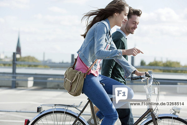 Germany  Berlin  Young couple with bicycle