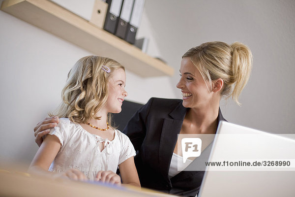 Germany  Ammersee  Diessen  Mother with daughter (6-7) using laptop  smiling  portrait