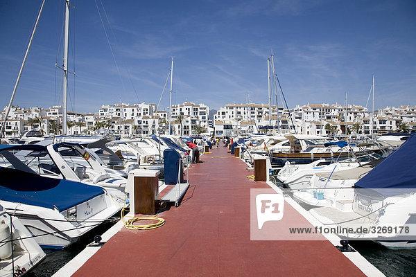 Boats moored at a harbor,  Marbella,  Malaga Province,  Andalusia,  Spain, Boats moored at a harbor,  Marbella,  Malaga Province,  Andalusia,  Spain