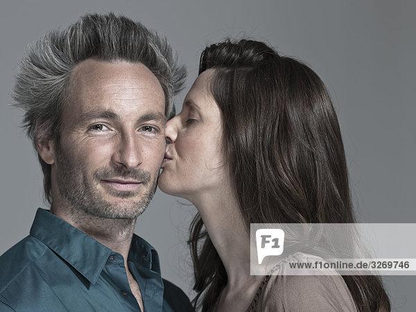 Couple  Woman kissing man