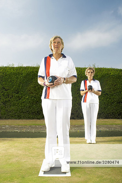 female bowls players on green