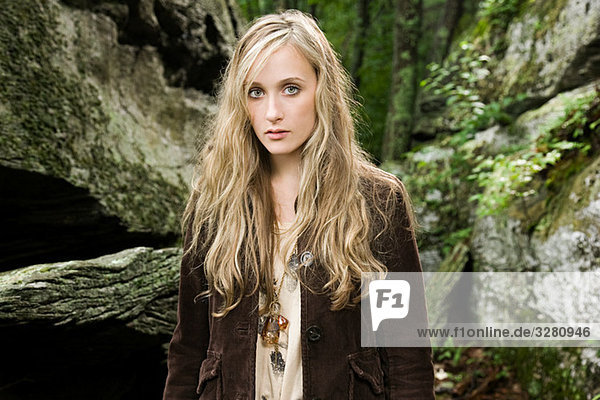 Young woman by rocks