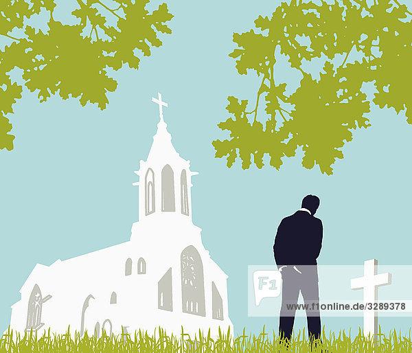 Mann besucht Friedhof