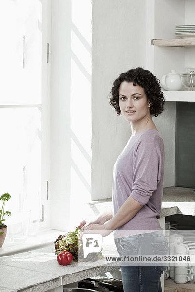 A woman preparing vegetables