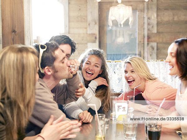 friends drinking in ski lodge bar