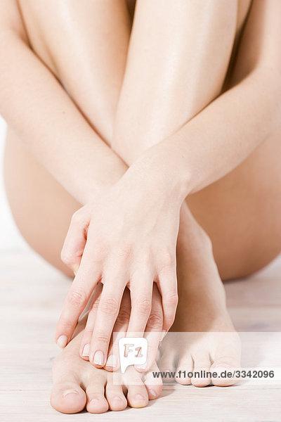 Nahaufnahme Frau Hände und Füße