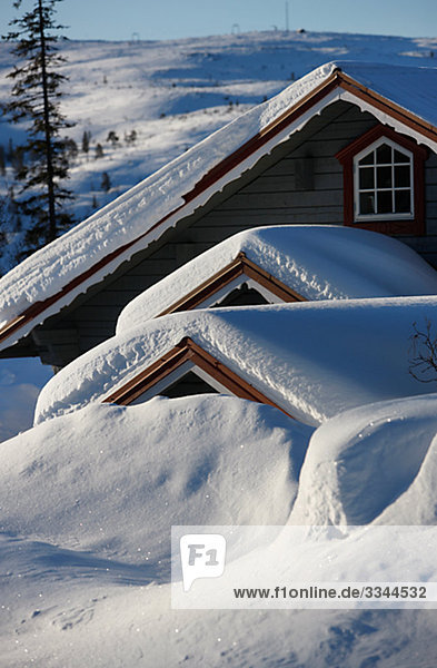 Mountain lodge covered in snow  Sweden.