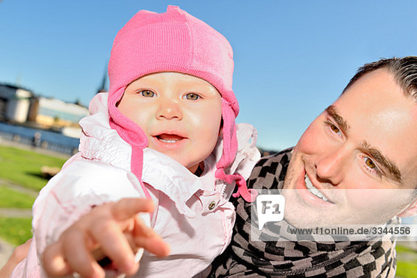 Father with his baby daughter  Sweden.