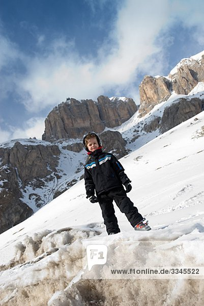 Porttrait of a skiing boy in the snow  Italy.