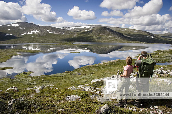 Two persons on a walking tour in the mountains,  Sweden.