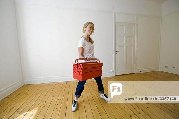 Woman working out with toolbox