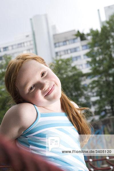 Portrait of red haired Girl on Spielplatz