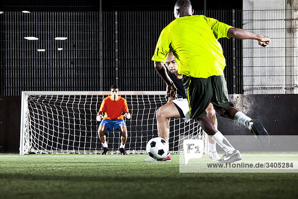scene in street football match player defending goal