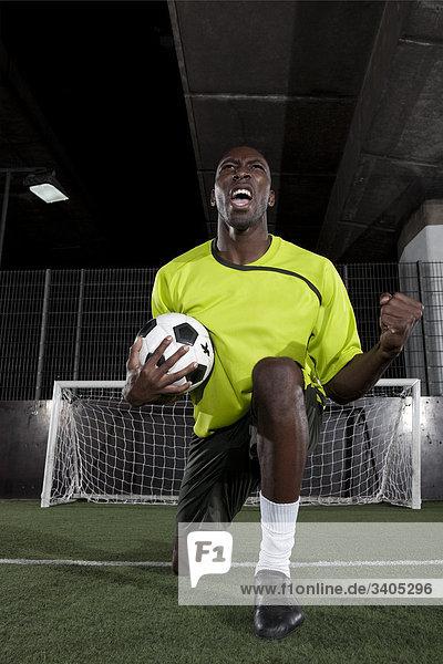 Portrait des Fußballspielers jubeln
