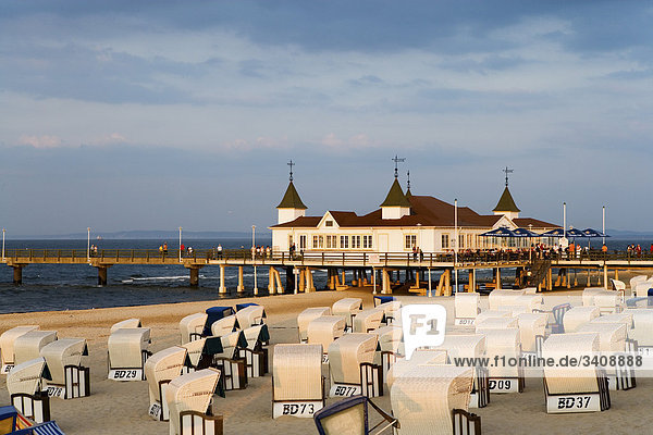 View of Ahlbeck pier  Hooded Beach Chairs in the foreground  Usedom  Germany  elevated view