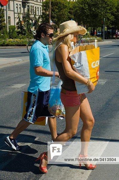 Couple with shopping bags Strandvägen street Stockholm Sweden Europe