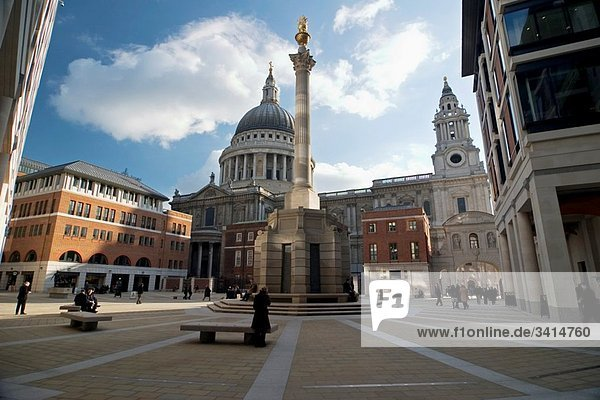 Paternoster Square right outside the London Stock Exchange with St Pauls Cathedral in the background Architects are Eric Parry Architects and Sheppard Robson Paternoster Square column is a Corinthian column of Portland stone topped by a gold leaf covere