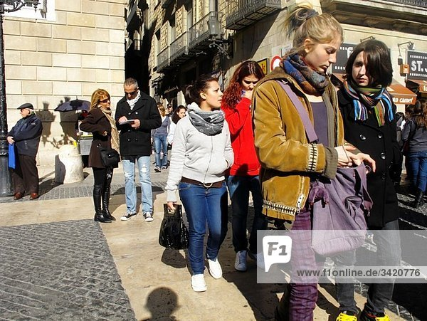 Young people at Sant Jaume square  in the Gothic quarter