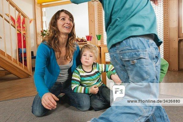 Germany  Nursery  Female nursery teacher and children playing together
