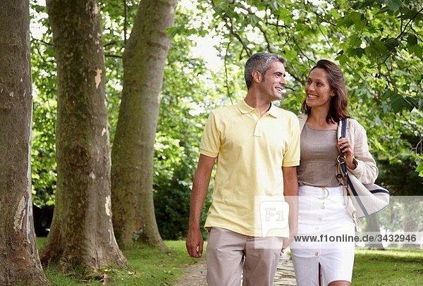 Couple walking in a garden  spa-relais. Lierganes hotel and spa  Cantabria  Spain