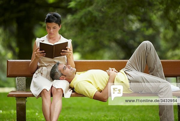 Woman reading a book and man in a garden  spa-relais. Lierganes hotel and spa  Cantabria  Spain