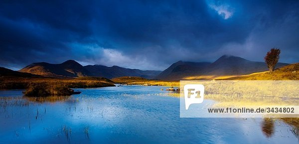 Scotland  Scottish Highlands  Rannoch Moor Lochan an Stainge located on Rannoch Moor with the dominating peak of the Black Mount and surrounding mountains in the distance