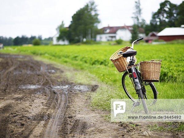 Scandinavia  Sweden  Smaland  Bicycle beside dirt road