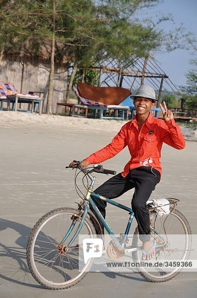 Sihanoukville (Cambodia): local boy on a bicycle at Otras Beach