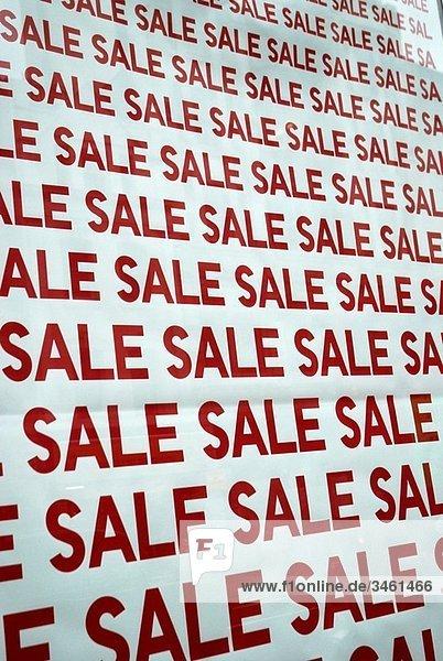 Sale signs in a shop window