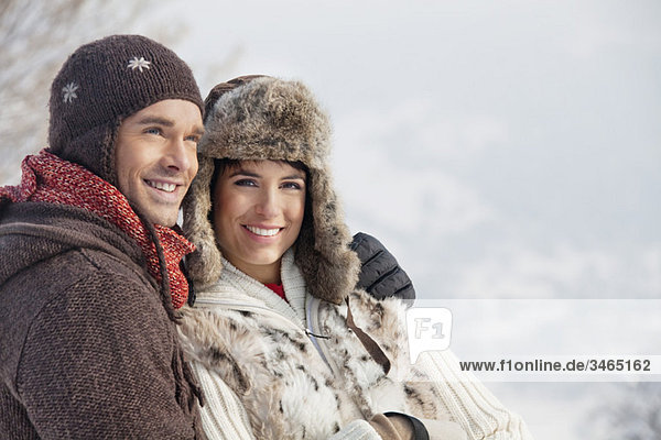 Young couple in winter clothes embracing