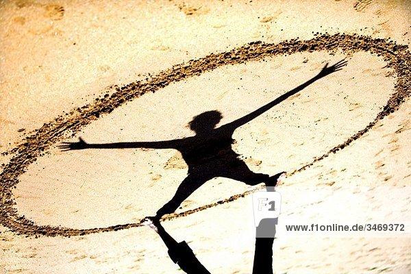 geometrical figure with sand and shadow