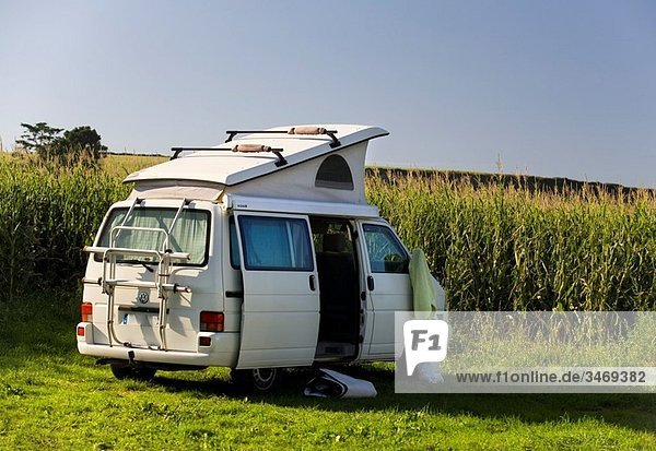 van in a cornfield