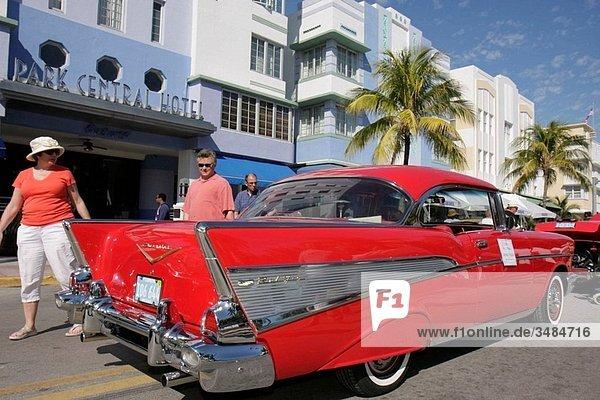 Florida  Miami Beach  ´Ocean Drive´  Art Deco Weekend  historic district  architecture  festival  event  celebration  classic car  exhibit  red  1957 Chevrolet  Bel Air  Park Central Hotel  man  woman  looking  chrome