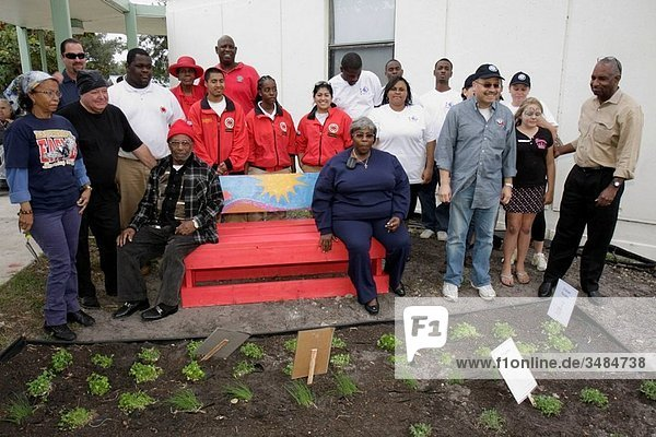 Florida  Miami  Little Haiti  Edison Plaza  public housing  Martin Luther King Jr. Day of Service  MLK  AmeriCorps  City Year  community service  student  volunteer  Black  Hispanic  man  woman  boy  girl  teen  group  team  herb garden  group
