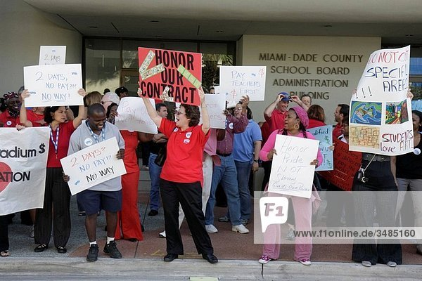 Florida  Miami  School Board Administration Building  education  budget cuts  economy  salary raise  pay  contract  money  teacher  teachers  professional  job  underpaid  protest  sign  poster  Black  woman  man  multi racial crowd  free speech