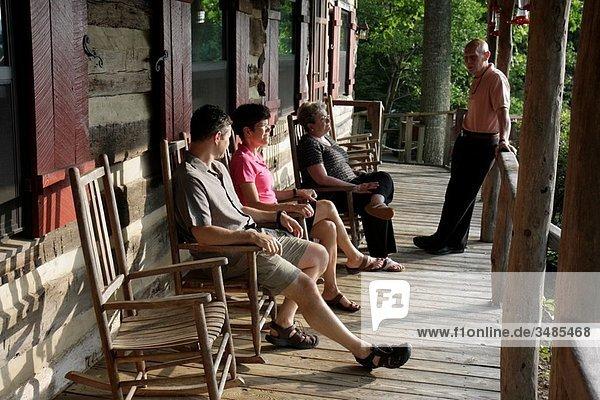 Virginia  Steeles Tavern  near Blue Ridge Parkway  Sugar Tree Inn  Bed and Breakfast  lodging  rustic  veranda  rocking chairs  man  woman  couple  relax  guests