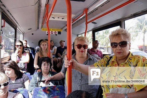 Florida  Miami Beach  South Beach  ´Washington Avenue´  Metrobus  bus  South Beach Local  public transportation  mass transit  woman  man  standing room only  full  holding pole