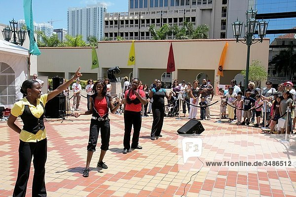 Florida  Miami  Cultural Center Plaza  Main Public Library  The Art of Storytelling International Festival  Steps in Order  hip hop  dance group  dacing  singing  Black  girl  boy  woman  man  teen  student  audience  multi ethnic  entertainment